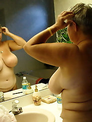 Voluptuous MILF is fingering herself