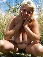 Older grandma is fingering her soaked holes