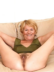 Naughty old hellcat is fingering herself