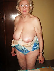 Hot-looking older bitch is posing totally undressed on picture