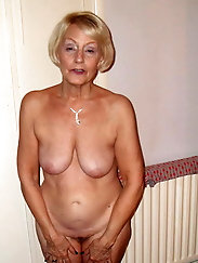 Busty old grandma is getting undressed on picture