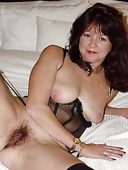 Extravagant older grandma is getting undressed