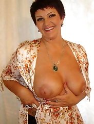 Adored aged dame is posing seminaked at home