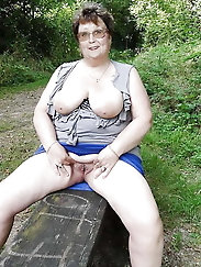 Grandmama is posing seminaked on the street